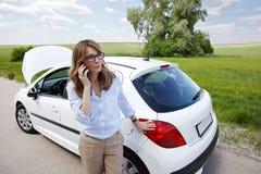 Woman with her broken down car Stock Photos