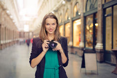Woman with her camera Stock Image