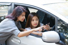Woman in her car and she asked friend about location on her smar Stock Images
