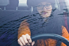 Woman in her car driving Stock Photos