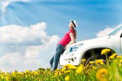 Woman and her car in the field Royalty Free Stock Photo