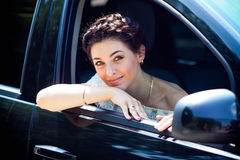 Woman in her car smiling. Royalty Free Stock Photos