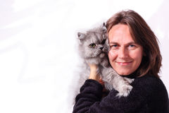 A woman and her cat. Isolated picture of a woman hugging a grey persian cat Royalty Free Stock Photos