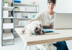 Woman with her cat Stock Photography