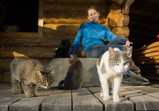 Woman with her cats Stock Images