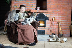 Woman and her cats stock photos