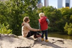 Woman and her charming little son admire the views in Central Park, new York royalty free stock image