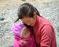 A woman with her child at Tibetan village in Ladakh, India Stock Image