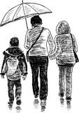 Woman with her children in the rain Royalty Free Stock Photo