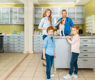 Woman and her children with their dog at veterinary doctor Royalty Free Stock Photo