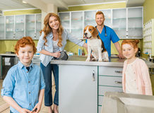 Woman and her children with their dog at veterinary doctor Royalty Free Stock Photos