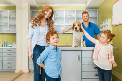 Woman and her children with their dog at veterinary doctor Royalty Free Stock Image