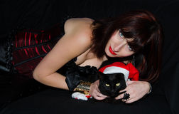 Woman with her christmas cat Stock Photo