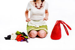 Woman and her clothes. Young woman and her clothes - after shopping, looking at new pants Stock Photography