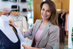 Woman in her clothing boutique Royalty Free Stock Image