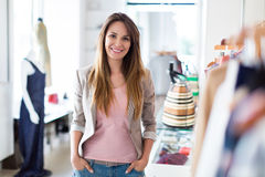 Woman in her clothing boutique stock images