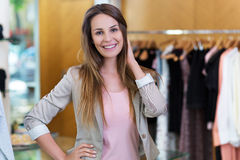 Woman in her clothing boutique stock photo