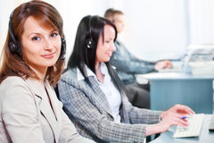 Woman and her colleagues Stock Photography