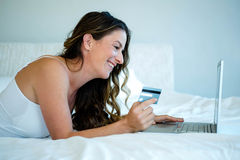 woman on her computer holding her credit card Stock Photography