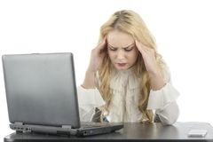 Woman at her computer, shocked about what is on the screen Royalty Free Stock Photography
