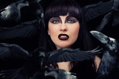 Woman with her crows. Beautiful dark woman with her crows royalty free stock image