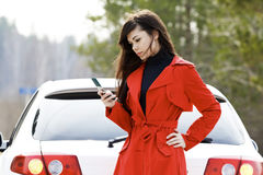 Woman and her damaged car Stock Photography