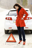 Woman and her damaged car Royalty Free Stock Images