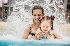 Woman and her daughter in aquapark stock photos