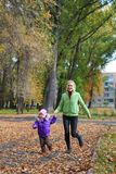 Woman  with her daughter in the autumn park Stock Photography