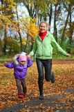 Woman  with her daughter in the autumn park Royalty Free Stock Images
