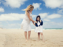 Woman and her daughter on the beach Royalty Free Stock Images