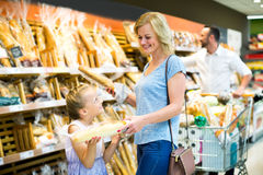 Woman and her daughter choosing bread Stock Photography