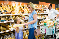 Woman and her daughter choosing bread Royalty Free Stock Photos