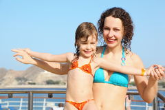 Woman with her daughter on deck of cruise ship. Smiling beautiful woman with her daughter on deck of cruise ship Stock Photo