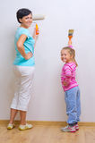 Woman and her daughter doing home repair. Happy women and her daughter doing home repair Stock Photos