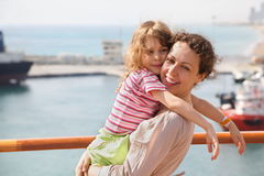 Woman with her daughter in focus. Stock Photos