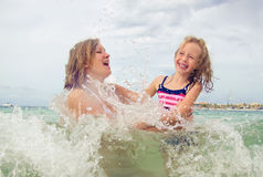 Woman and her daughter having fun. Royalty Free Stock Image