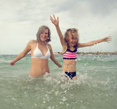 Woman and her daughter having fun. Stock Image