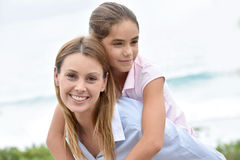 Woman with her daughter on her back Royalty Free Stock Photo