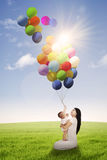 Woman and her daughter playing balloon Stock Photo