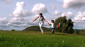 Woman and her daughter playing with kite Royalty Free Stock Images