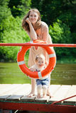 Woman and her daughter posing with buoy Royalty Free Stock Photography