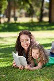 Woman with her daughter reading a book Royalty Free Stock Image