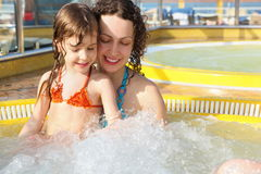 Woman with her daughter is relaxing in hot tub. Beautiful woman with her daughter is relaxing in hot tub on cruise ship Stock Photos