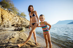 Woman and her daughter standing at the beach Royalty Free Stock Image