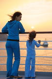 Woman and her daughter standing on deck of ship Royalty Free Stock Photography