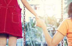 Woman and her daughter take swing for relaxing Royalty Free Stock Images