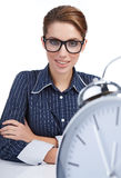 Woman at her desk at the end of the day Royalty Free Stock Photos