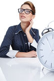 Woman at her desk at the end of the day Royalty Free Stock Images