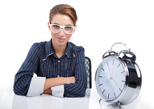Woman at her desk at the end of the day Royalty Free Stock Photo